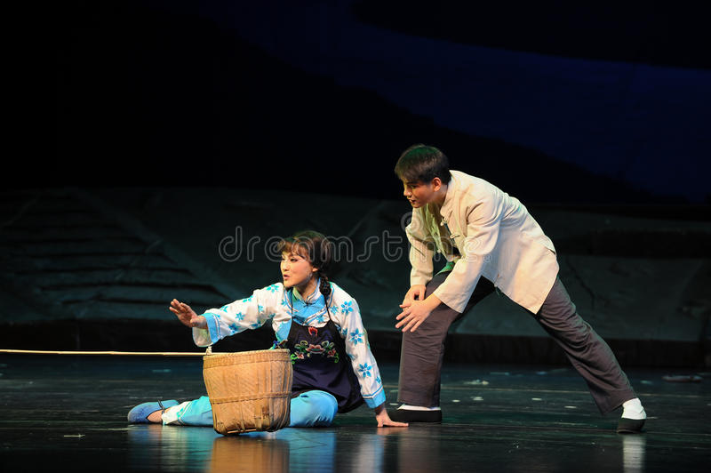 Rescue- Jiangxi opera a steelyard. Jiangxi opera a steelyard is adapted from a true story: the last century fortys, the protagonists father runs an oil mill in royalty free stock photography
