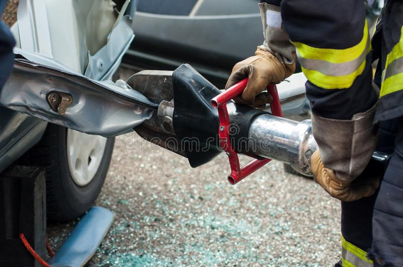 rescue man with pneumatic machine on crashed car royalty free stock images