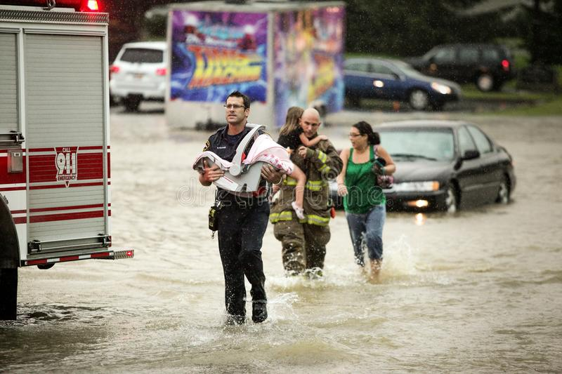 Rescue Me 5003. First responders rescue a family from their car stuck in flooded waters. Help in time of trouble royalty free stock images