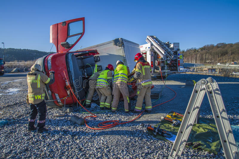 Rescue of an person in a overturned panel van