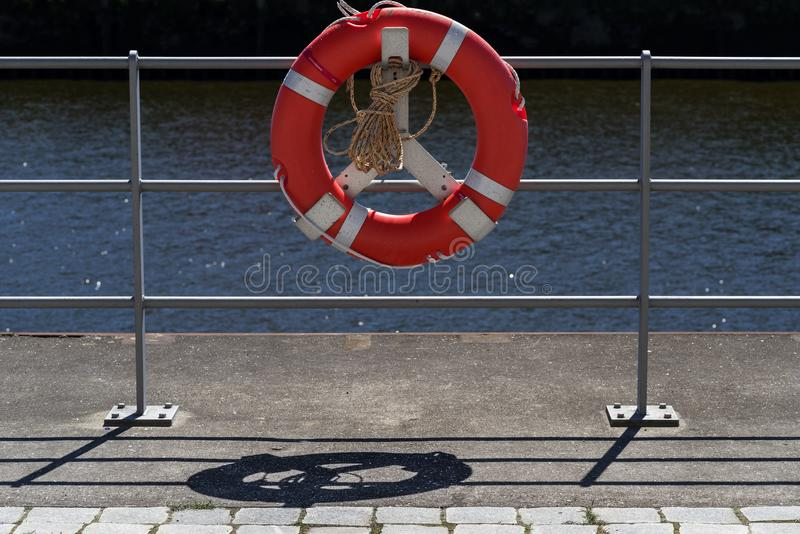 Rescue ring on the railing in the harbor royalty free stock photography