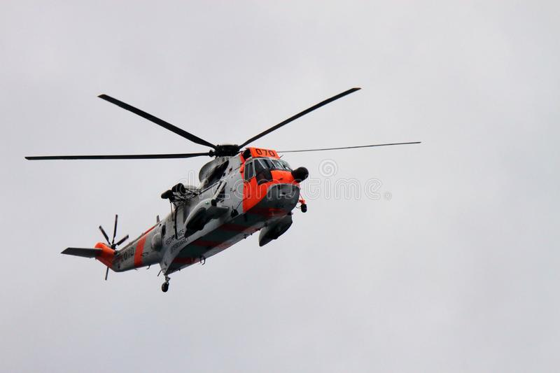 Rescue Sea King helicopter flying on Lofoten. Coast Guard Sea King helicopter flying on Lofoten islands, arctic archipelago situated in northern Norway, in stock photos