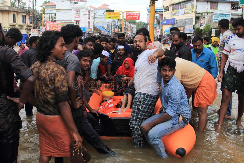 Rescue team help people to escape from flooded area stock photo