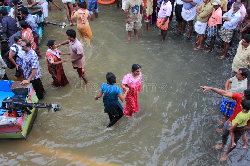 Rescue team help people to escape from flooded area stock image