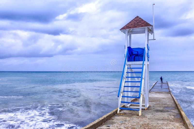 Rescue tower on the shore of a stormy sea stock photo
