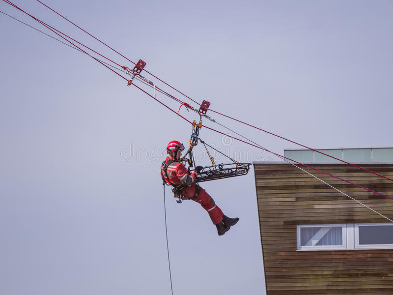 Rescue workers in action. ALMERE, NETHERLANDS - 12 APRIL 2014: Rescue workers during an abseiling demonstration at the first National Security Day held in the royalty free stock image