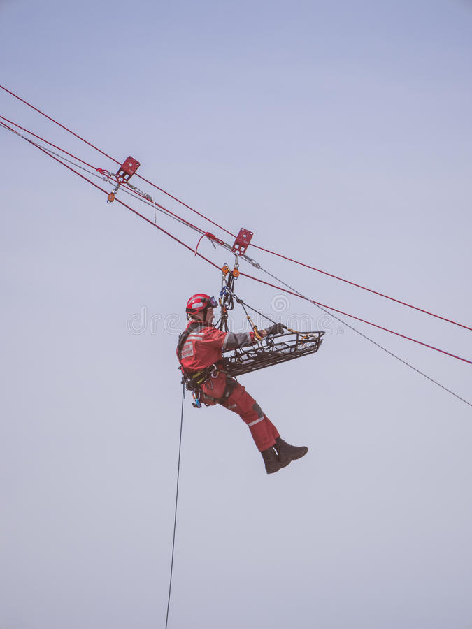 Rescue workers in action. ALMERE, NETHERLANDS - 12 APRIL 2014: Rescue workers during an abseiling demonstration at the first National Security Day held in the stock photography