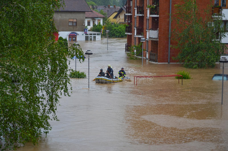 Rescue workers in the boat during floods. In Bosnia 2014 royalty free stock photos