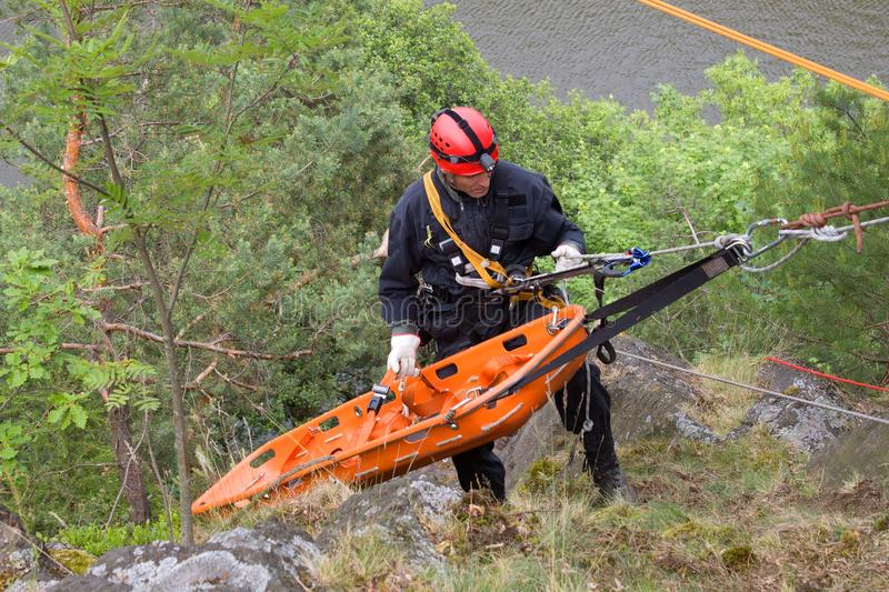 Rescuer on the rope, exercise special police units royalty free stock photography