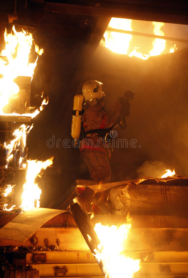 Rescuer search victims on fire stock images