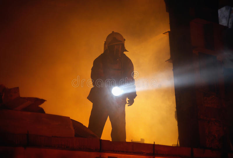 Rescuer search victims in smoke stock images