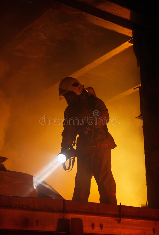 Rescuer search victims in smoke royalty free stock photo