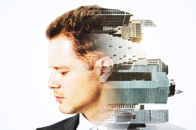 Research concept. Side portrait of handsome man and sideways turned city on white background. Double exposure. Research concept royalty free stock images
