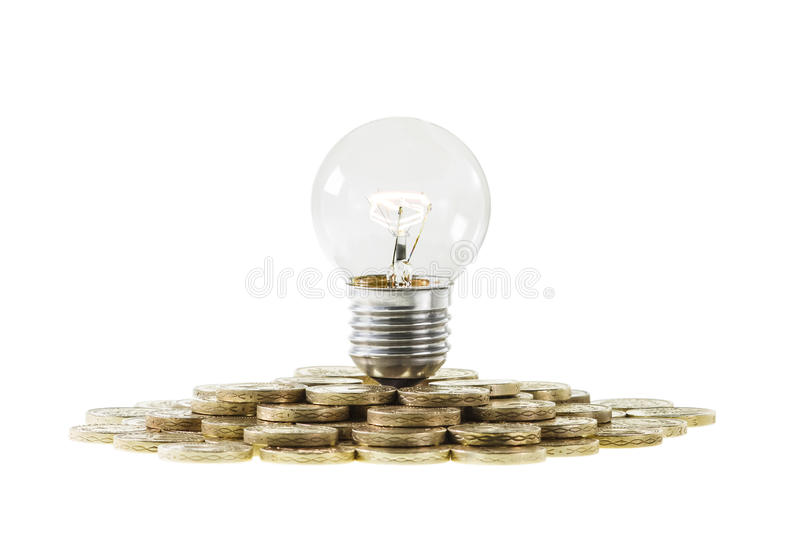 Research Funding Concept Light Bulb on Pile of Coi stock image