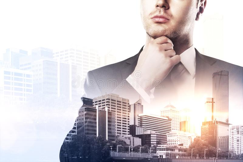Research and job concept. Thoughtful young european businessman on blurry city background. Research and job concept. Double exposure royalty free stock images