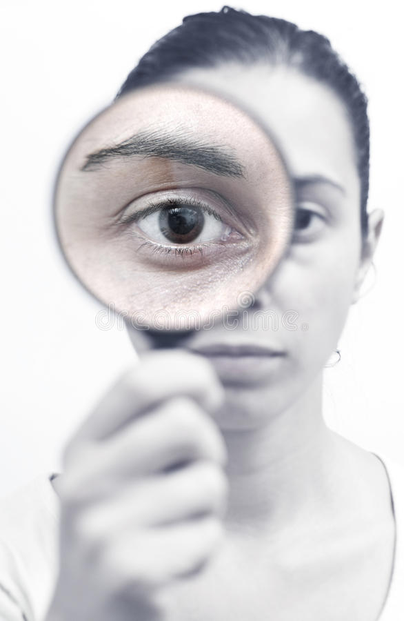 Research with a magnifying glass royalty free stock photo