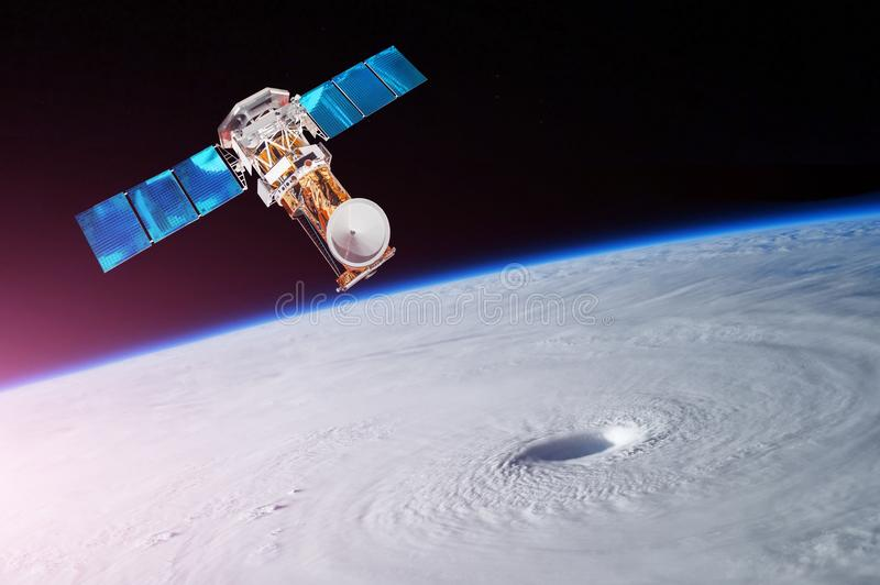 Research, probing, monitoring of tracking in a tropical storm zone, a hurricane. Satellite above the Earth makes measurements of t royalty free stock image