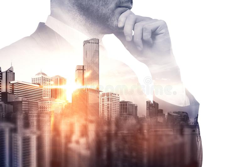 Research and success concept. Thoughtful young european businessman on blurry city background. Research and success concept. Double exposure stock photography