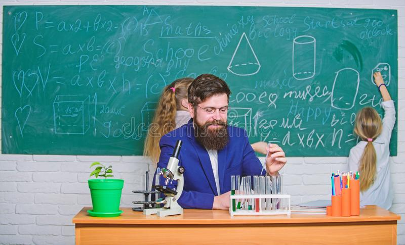 Research and training activities. Teacher and elementary school children in research laboratory. Science teacher and. Pupils doing research work. Experimental stock image