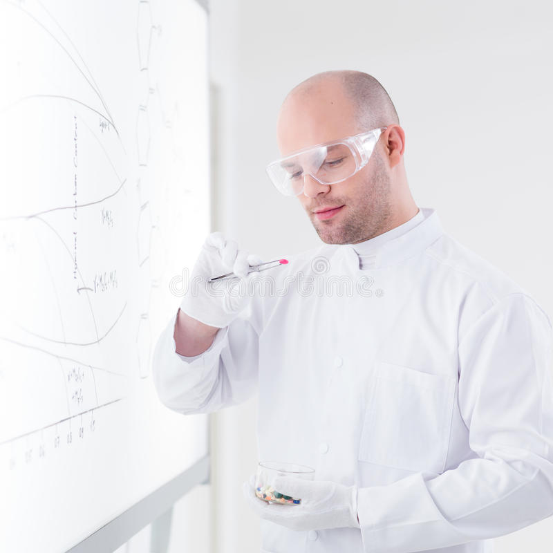 Researcher Analyzing Pills Stock Images