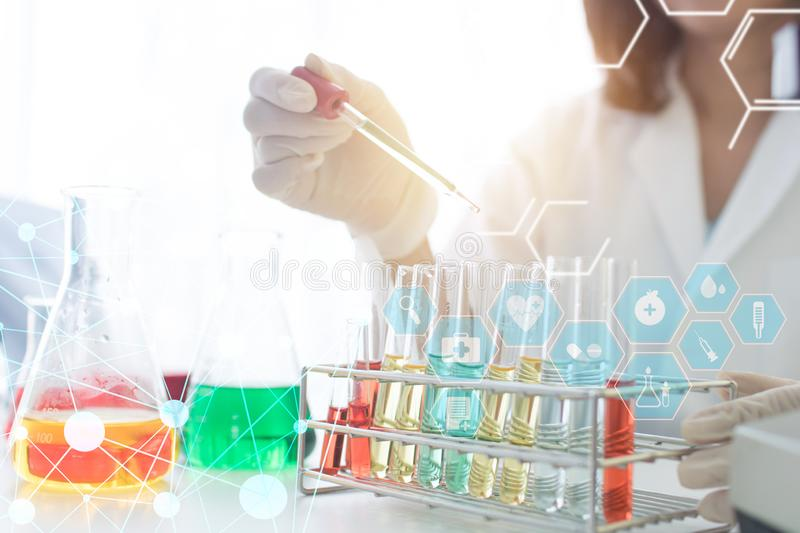 Researcher and development making research with scientific and medical lab instrument in clinical laboratory, Scientist test tube royalty free stock image