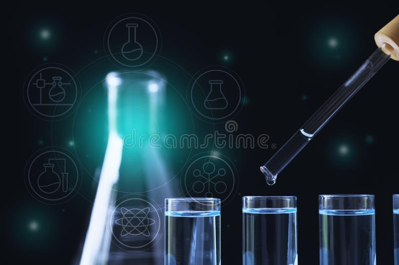 Researcher with glass laboratory chemical test tubes with liquid for analytical , medical, pharmaceutical and scientific research. Concept royalty free stock images
