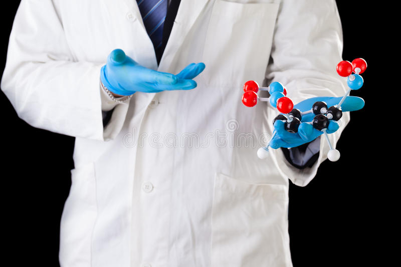Researcher holding a tnt molecule stock images