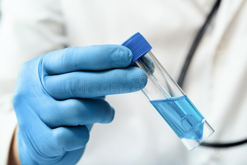 Researcher in the laboratory preparing a sample of antibiotic for the vaccination campaign royalty free stock photography