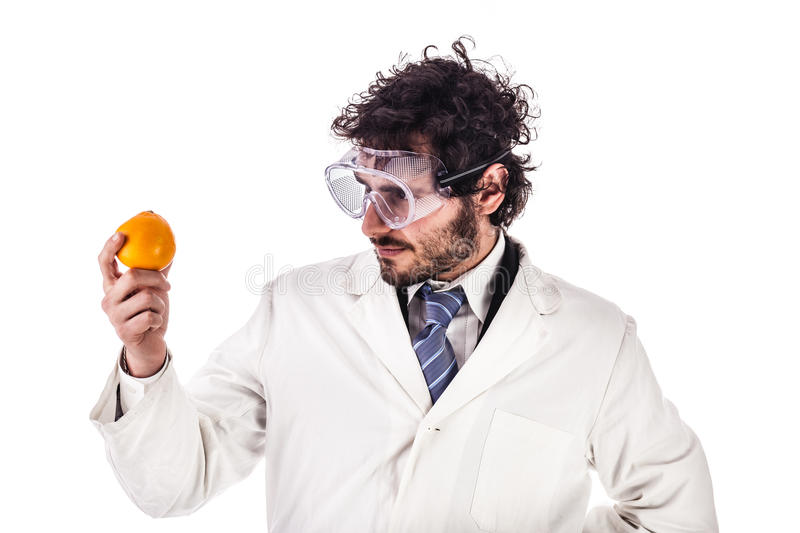 Researcher looking at an orange royalty free stock photo