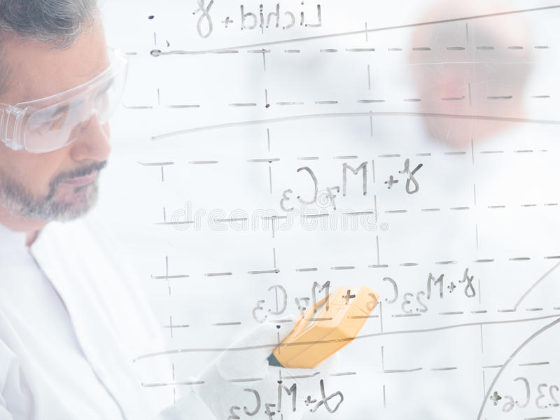 Download Researcher Scanning In A Lab Stock Photo - Image of math, costume: 31258348