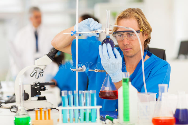 Researcher scientific research. Confident researcher carrying out scientific research in a lab royalty free stock images