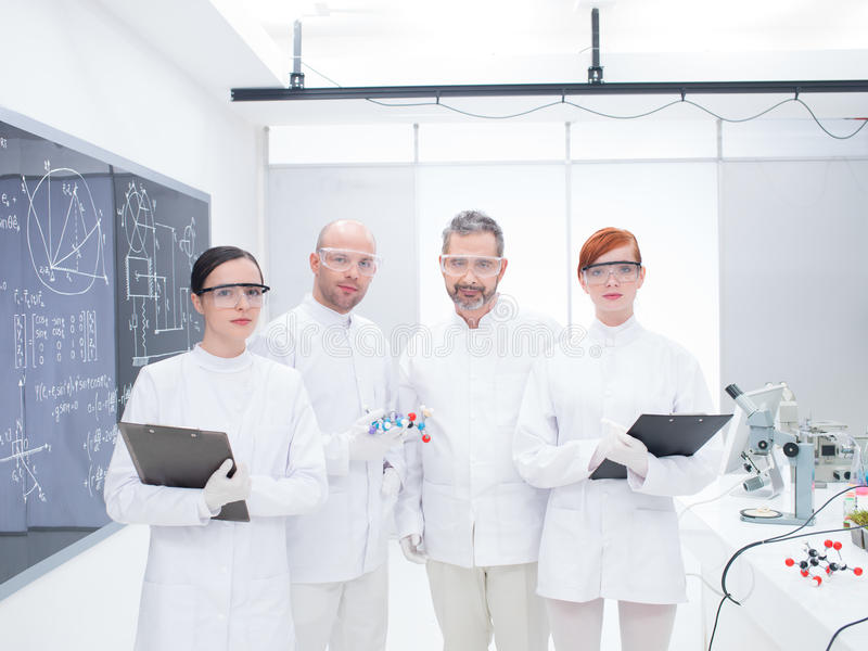 Download Researcher Team In Laboratory Stock Photo - Image of blackboard, costume: 31258464