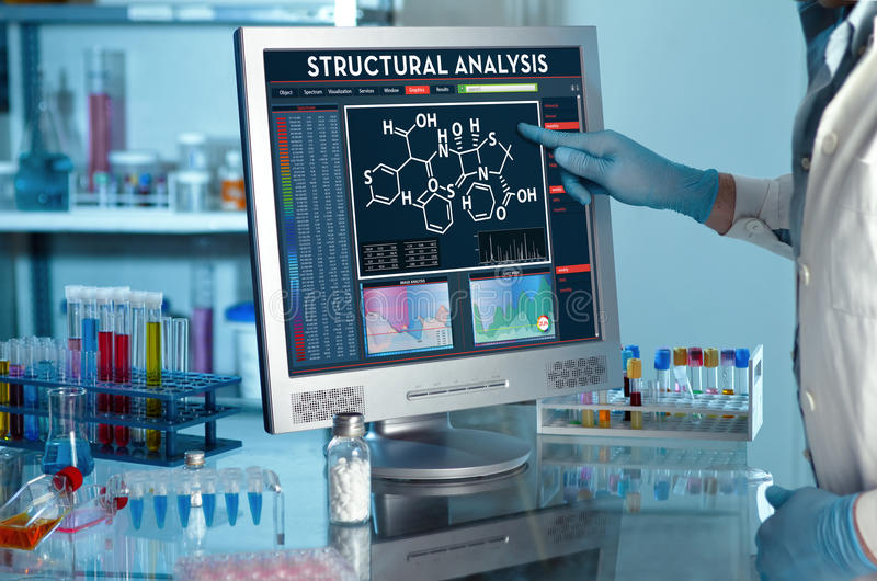 Researcher touching the screen of report of structural analysis stock image