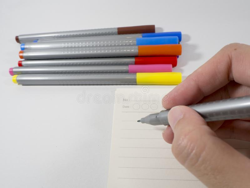Take notes with a variety of pens Will make the brain to remember more than just using one color pen stock image