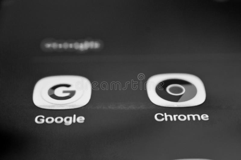 RESEN, MACEDONIA. MARCH 25, 2019-Google and Chrome icons on a smartphone screen, Monochrome close up photo, shallow dof. RESEN, MACEDONIA. MARCH 25, 2019-Google stock photography