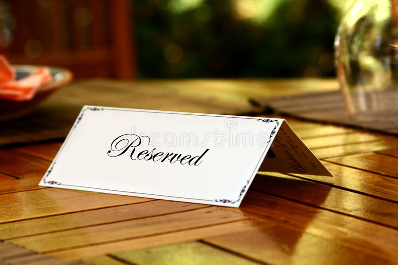 Reservation. Card on a Table stock photos