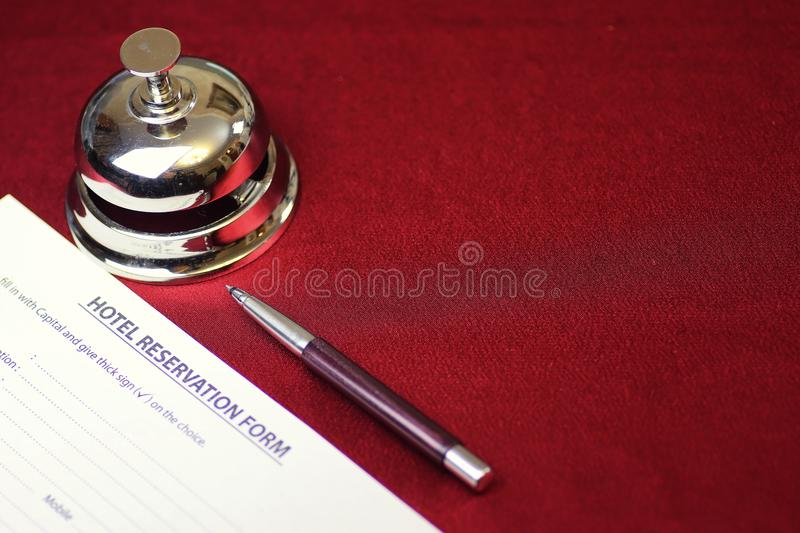 Reservation of the hotel room. And filling in the necessary documents royalty free stock photography