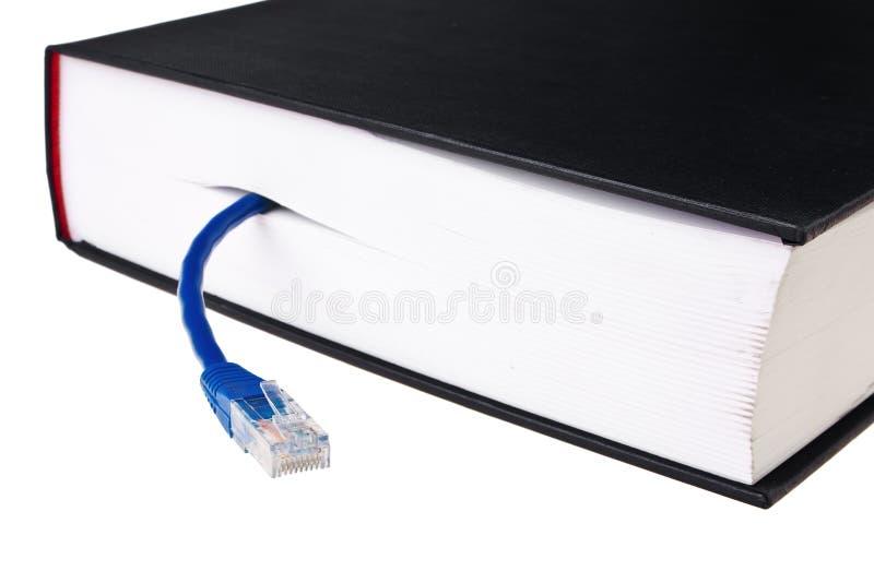 Reserve en hardcover con la cuerda de corrección azul del LAN. imágenes de archivo libres de regalías