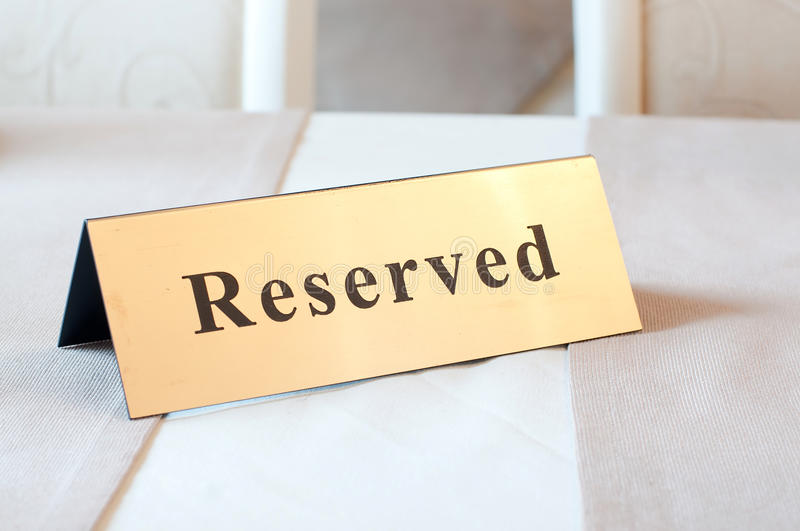 Reserved sign, reservation. On table. Gold color. Reserved sign, reservation. On table stock images