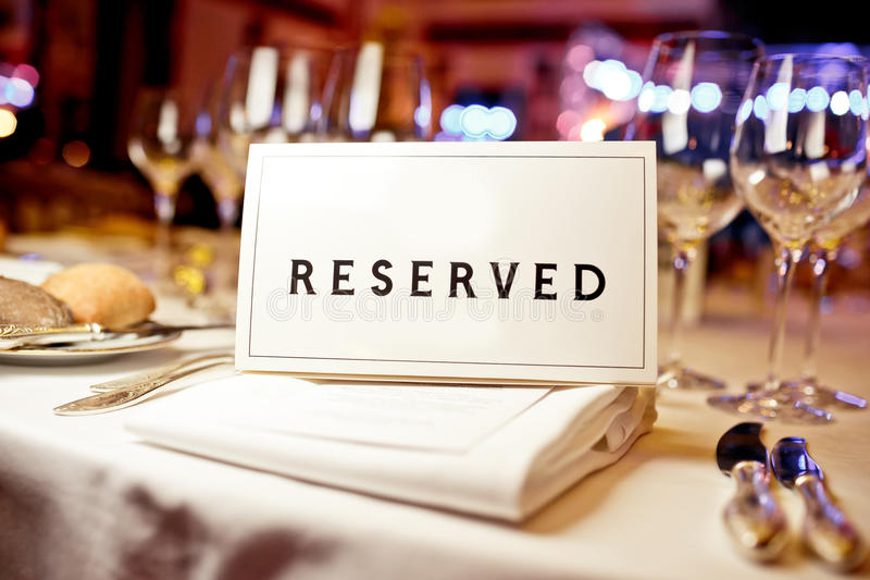 Reserved sign. On a table in restaurant royalty free stock photo