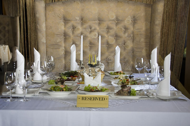 Reserved table in restaurant. Reserved table in luxury restaurant royalty free stock image