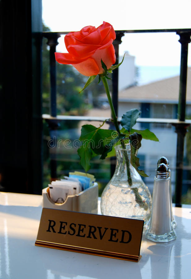 Reserved Table Sign with Rose royalty free stock image