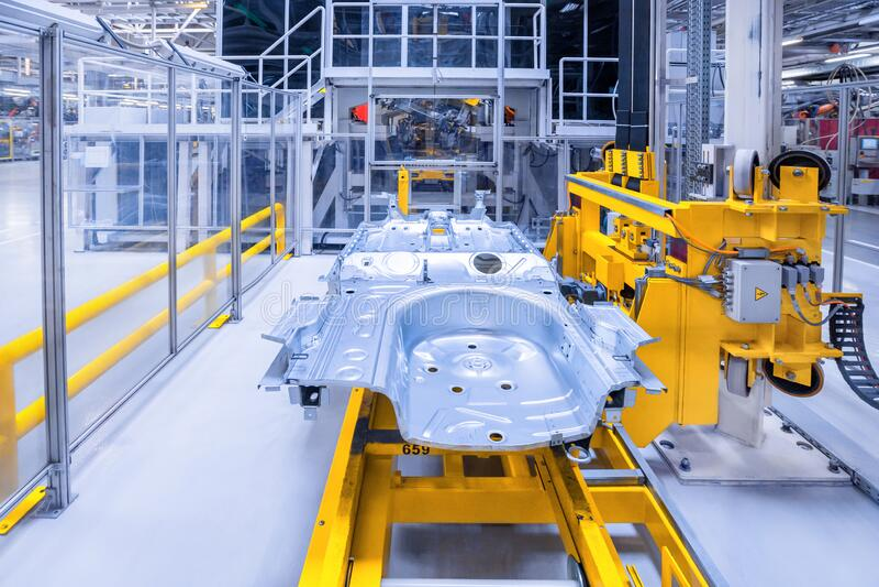 Reserveonderdelen in een autofabriek stock afbeelding