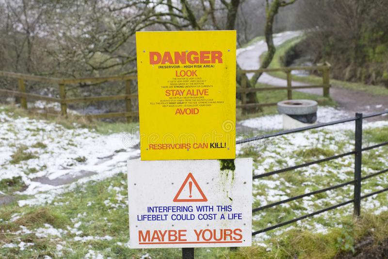 Reservoir deaths safety danger sign at deep water countryside park. Uk stock photography