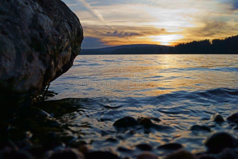Reservoir sunset rocky shore royalty free stock photo