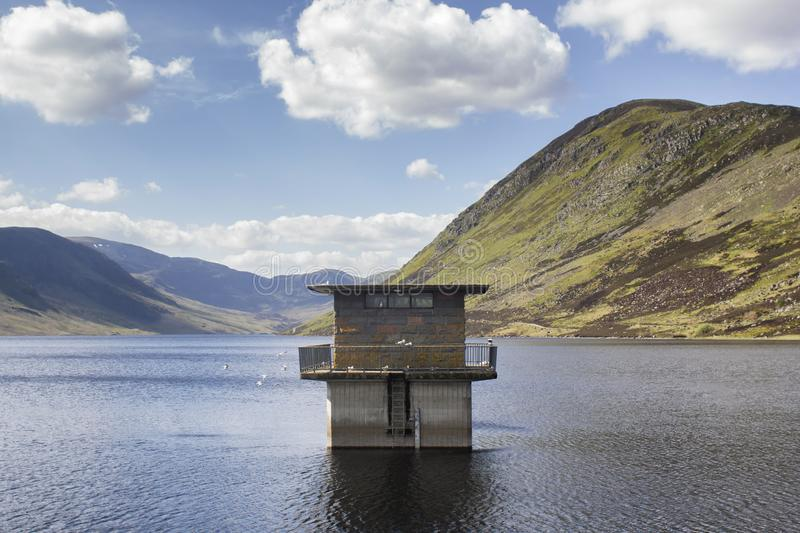 Loch Turret and Ben Chonzie in the Highlands on a sunny summers day. The reservoir tower in Loch Turret and Ben Chonzie in the Highlands, Perthshire area in royalty free stock photos