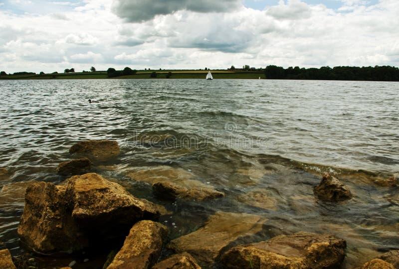 Reservoir under moody skies stock photo