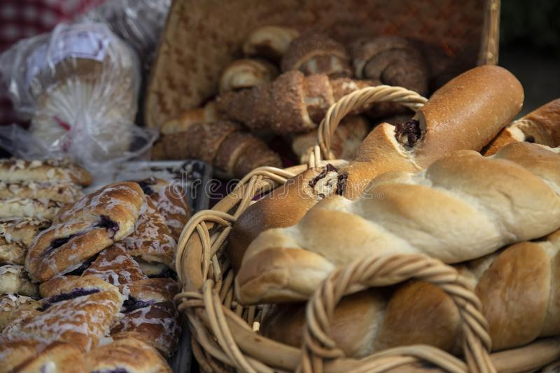 Reshly Baked Organic Loaves of Bread in Baskets, Pastries on Bake Pans stock photography