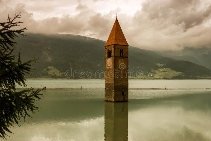 Resia Lake. Reschensee (Resia) is an artificial lake in Italy's region Trentino Alto Adige. The 14th century church is the remain of a small village submerged by stock photo