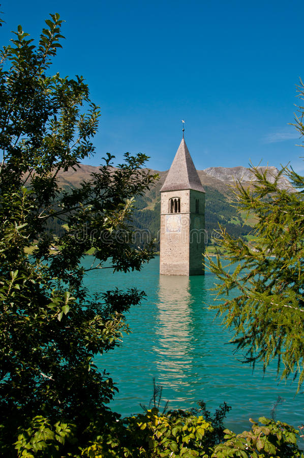 Resia lake (Italy) - The submerged bell tower. The submerged bell tower - Resia lake (South Tyrol stock photo